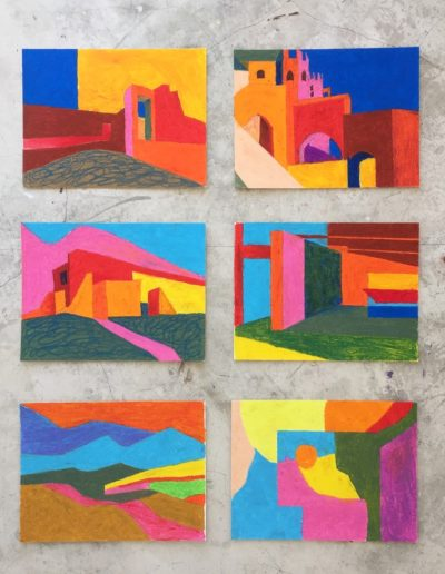 A two by three array of oil pastel drawings on paper, affixed to a concrete wall. The mottled grey surface amplifies the bold, flat colours of the abstract city- and landscapes.